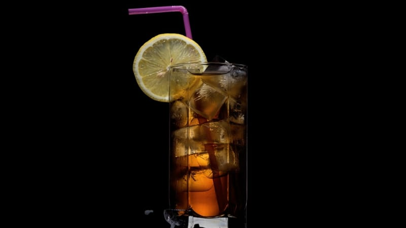 Long Tall Black with a lemon slice and a straw