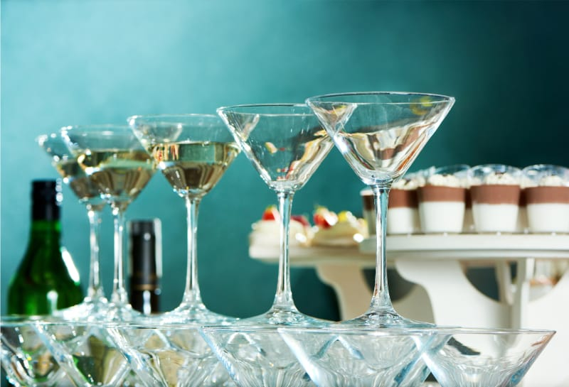 low angle close up shot martini glasses, party table, restaurant dinnerware and glassware