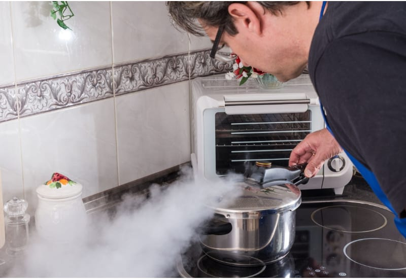 Man checking out a pressure cooker