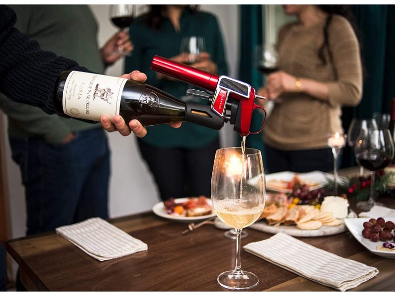 Man pouring wine using Coravin Model Two Elite Pro Wine Preservation System