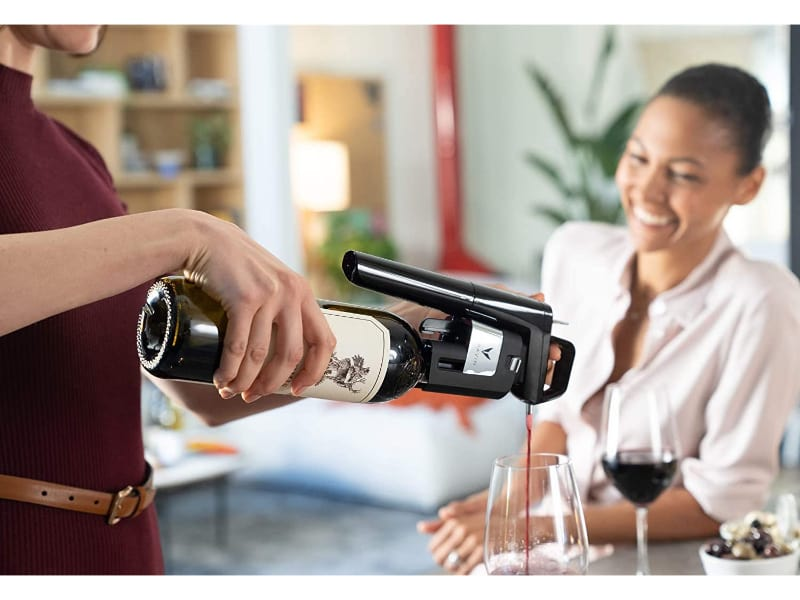 Man pouring wine using Coravin wine preserver