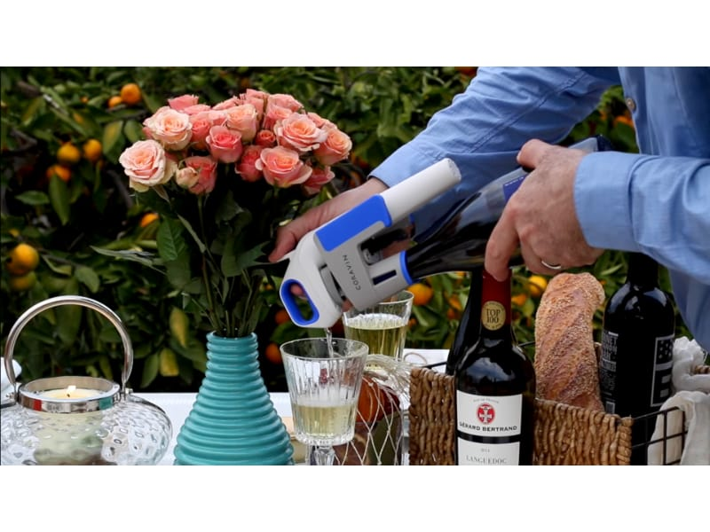 Man pours white wine using Coravin model one