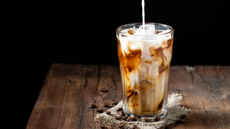 Milk being poured in a Kahlua iced coffee