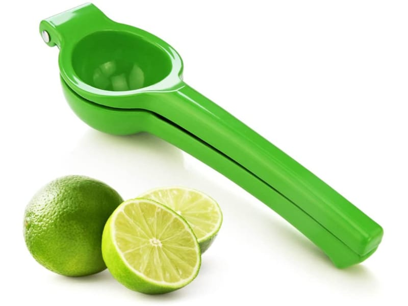 New Star Enameled Aluminum Lemon Squeezer in the color green with fresh lime on the side