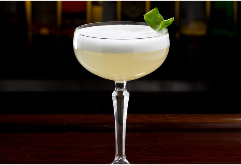 Pisco Sour garnished with cucumber peel