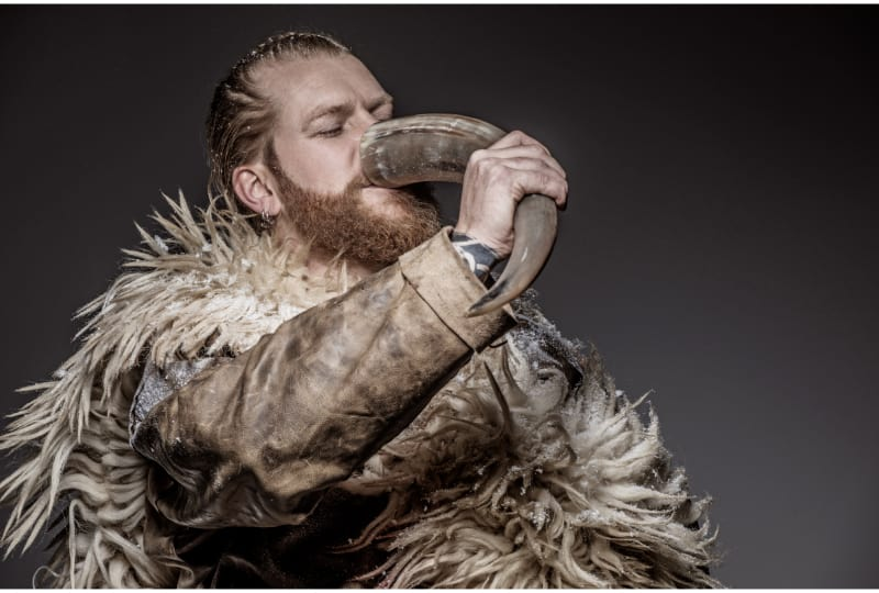 Portrait of a Viking warrior drinking mead from a horn
