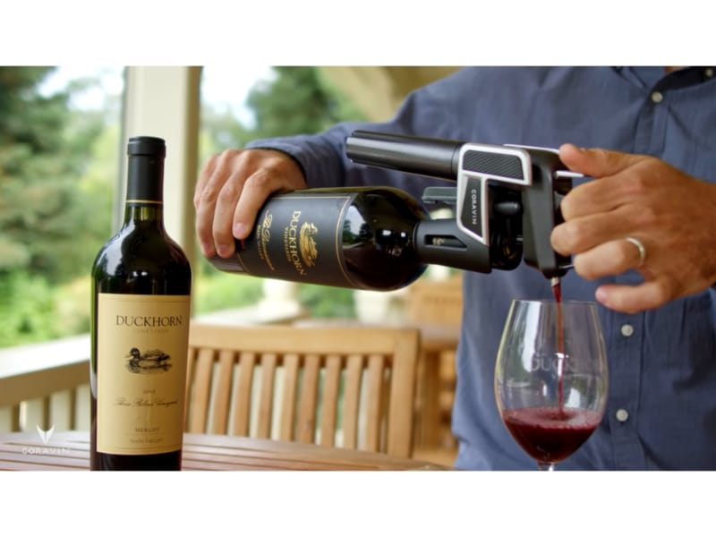 Pouring the bottle of red wine using the Coravin Model Three