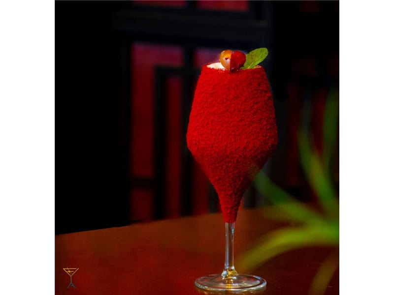 Red velvet cocktail in a tulip glass