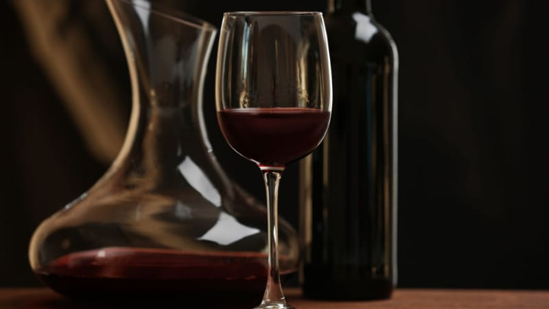 Red wine glass with decanter and bottle