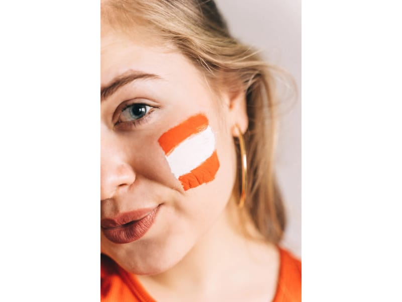 woman with orange and white face paint