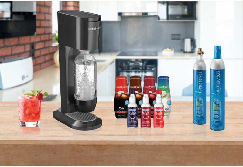 SodaStream Machines, a glass, and syrups and Co2 Tank