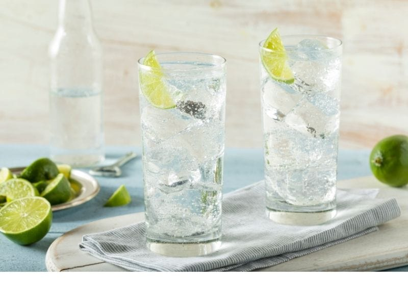 Sparkling water with lime on top of a table