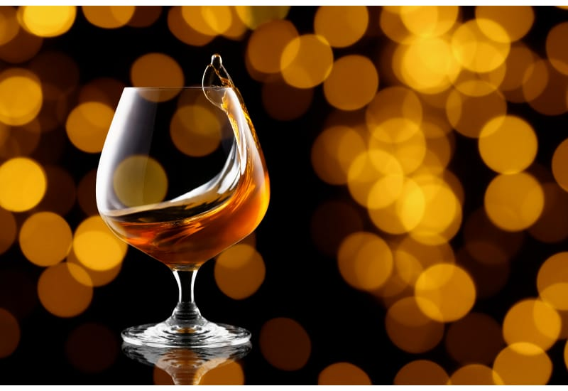 Splash of brandy in snifter glass