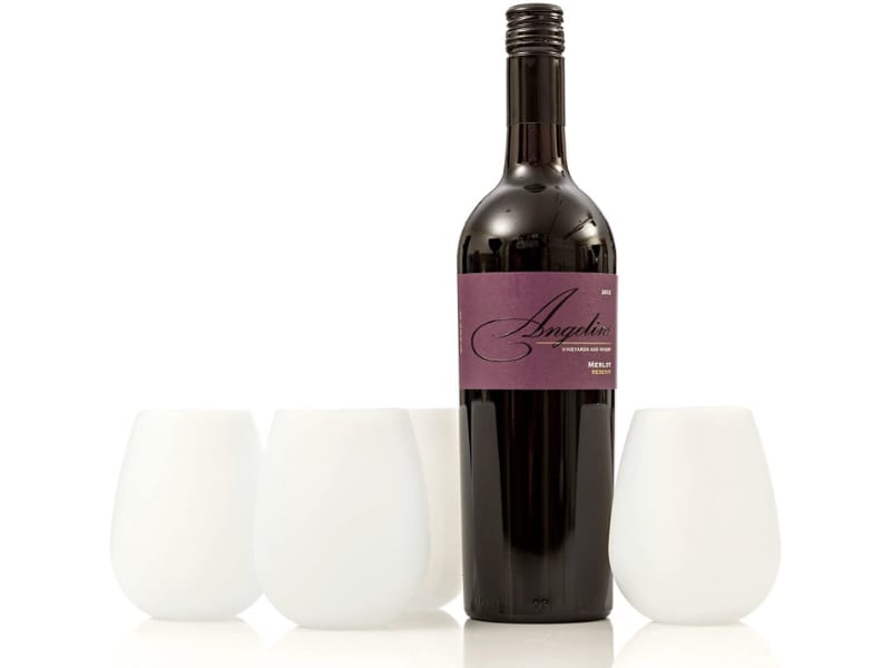 White, stemless silicone wine glasses with a bottle of Merlot wine.