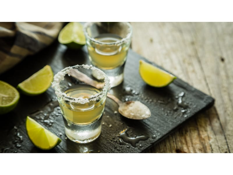 Tequila shots with lime slices and salt