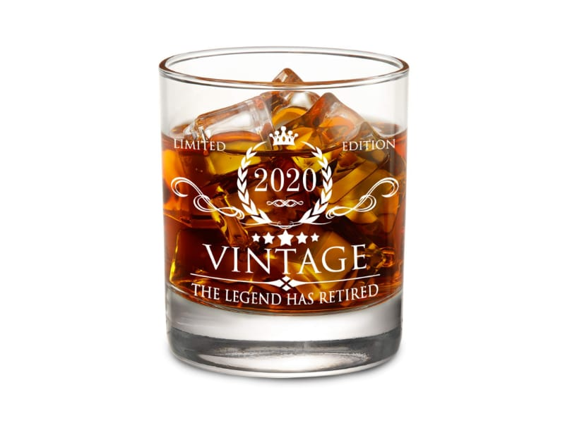 """Whiskey Glass with """"The Legend has Retired"""" label"""