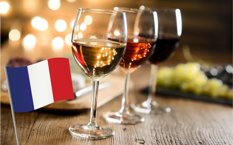 three glasses of wine with France's flag