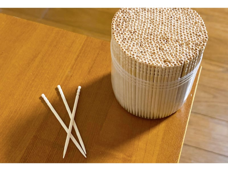 Toothpicks in a plastic container