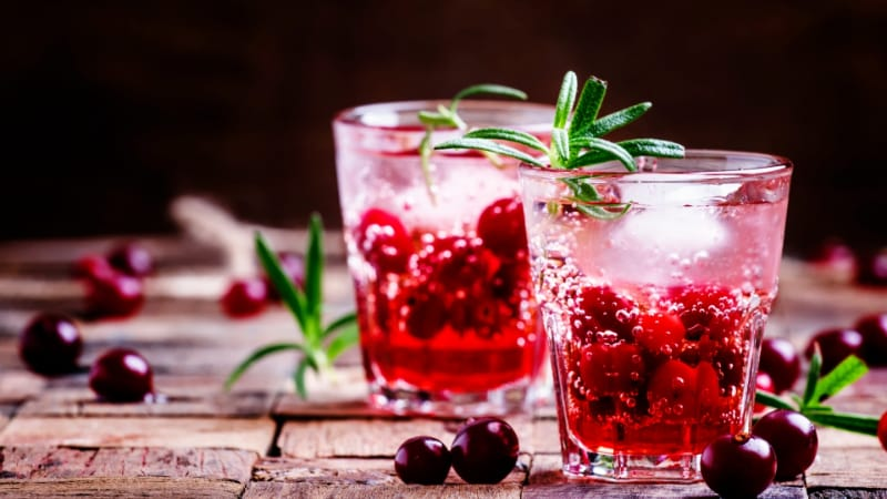 Two-layer cocktail with cranberry, vodka, rosemary