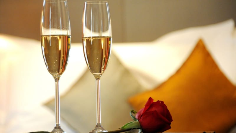 Two champagne flute glasses with rose