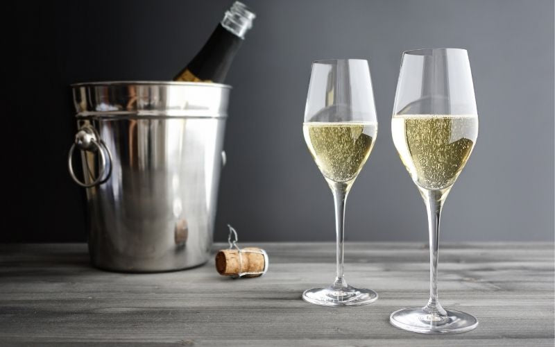 two glasses of Prosecco with the bottle in a bucket