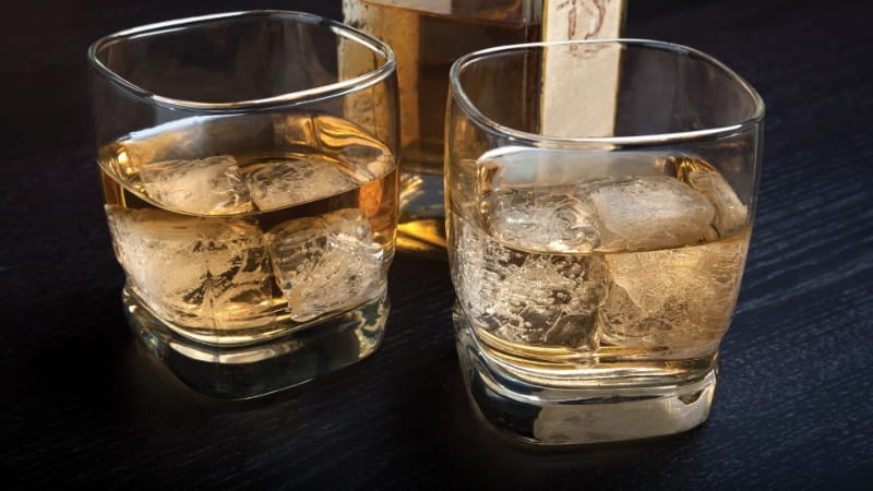 Two glasses of butterscotch Vegas bomb