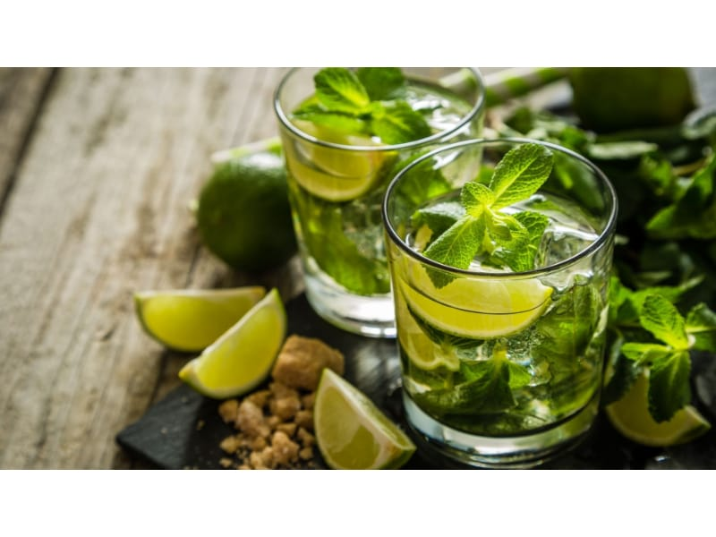 Two glasses of Mojito with lime and mint leaves