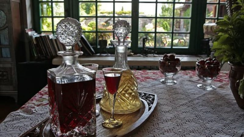 Two old whiskey decanters on a tray