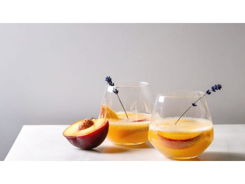 Two servings of peach smash with fresh peach