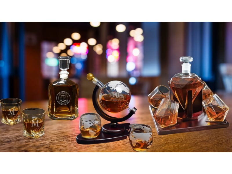 Various types of whiskey decanters on a bar tabletop