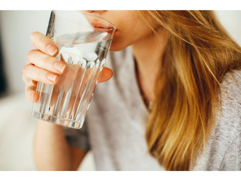 Girl sipping a glass of water