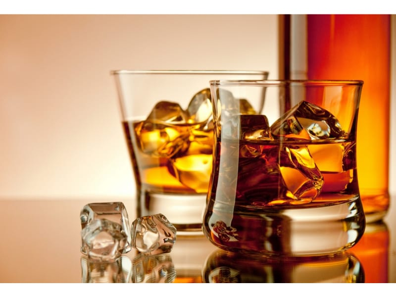 Whiskey and bourbon glasses with ice