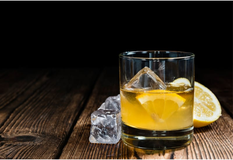 Whiskey Sour with ice and lemon