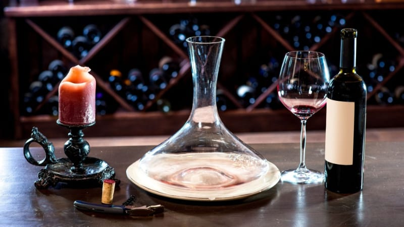 Wine decanter with wine glass and bottle of wine