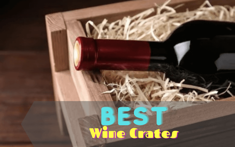 A wine crate with wine bottles and a glass of wine