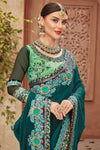 Green Saree and matching Blouse with heavy embroidery