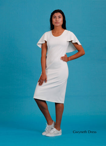 White stretch knee length dress with cape