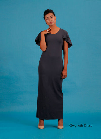Long charcoal coloured dress with cape