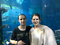 fashion designer and husband at aquarium