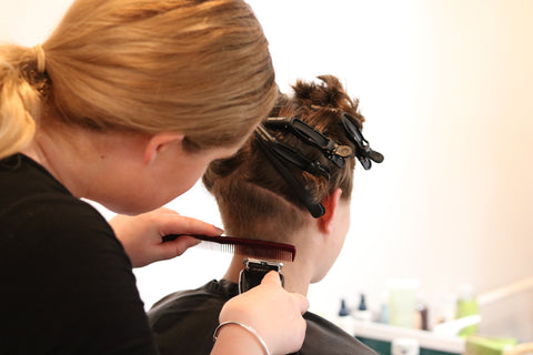 kiwi designer shaving her head