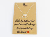 Joined heart pendant necklace