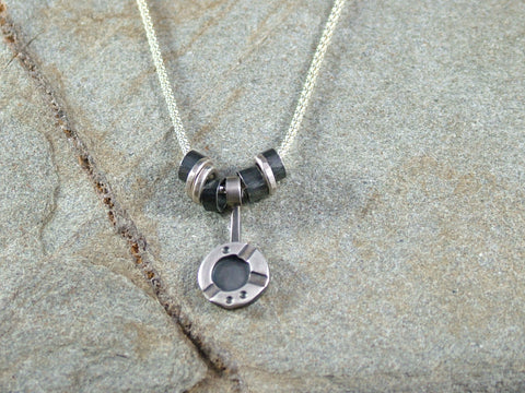 Charm Necklace with Seven Silver Rings