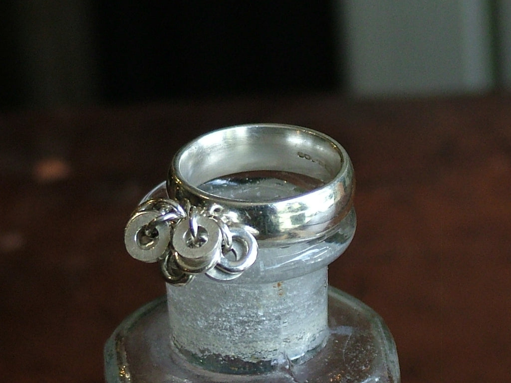 Vintage and Preloved Chunky Band with Ten Silver Rings