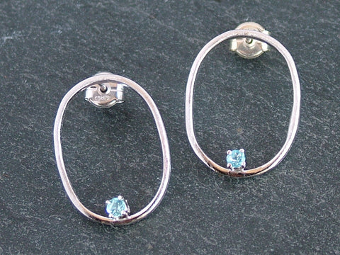 Oval Silver Earrings with Blue Topaz