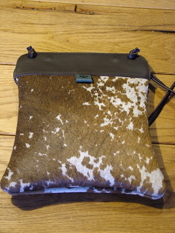 Brown and White Cow Skin Pub Bag