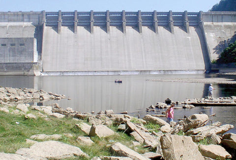 Fishing Down Stream Of Dam