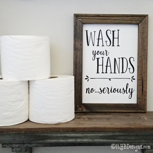 "Dark walnut stained 9""x12"" frame on a white canvas with black words that read, ""Wash your hands, no...seriously."" Design is placed vertically on sign."