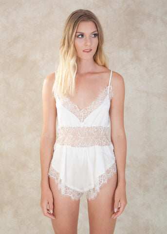 By Salua. This exquisite romper is made with stretch silk and delicate eyelash lace. The flirtatious lace placement adds sheerness in all the right places. Available at Koki Intimi.