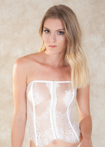 By Salua. The Angeletta Corset is crafted with romantic sheer lace, hook-and-eye front closure on  and a seductive lace-up back. The Angeletta Corset is an absolute must! This beauty can be paired with the Angeletta Thong for a sensual yet elegant bridal look. Available at Koki Intimi.