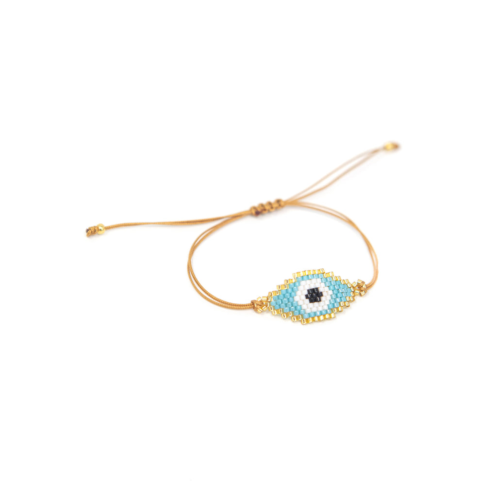 Beaded Evil Eye Adjustable Cord Bracelet JEWELRY The Sis Kiss White Eye on Turquoise Background